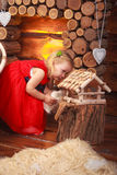 Little cute girl near the fireplace. Smiles, laughter, joy, happiness, street, village. Stock Image