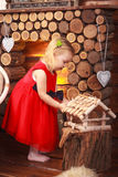 Little cute girl near the fireplace. Smiles, laughter, joy, happiness, street, village. Little cute girl near the fireplace. Smiles, laughter, joy, happiness Stock Photography