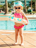Little cute girl near the pool Royalty Free Stock Image