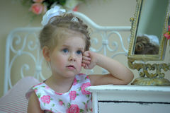 Little cute girl next to the mirror Royalty Free Stock Photos