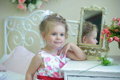 Little cute girl next to the mirror Royalty Free Stock Images