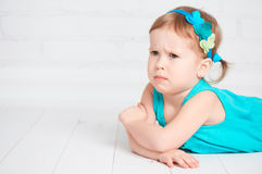 Little cute girl offended, angry frown Royalty Free Stock Image