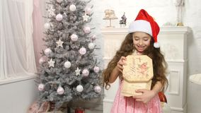 Little cute girl opening Christmas gift box stock video footage