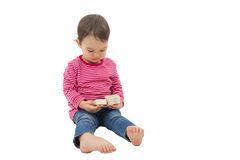 Little cute girl opening a gift box, isolated on the white Stock Photography