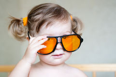 Little cute girl with orange sunglasses Royalty Free Stock Image