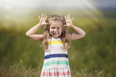 Little cute girl outdoors smiling happy in the sunlight. Portrait closeup Royalty Free Stock Photo