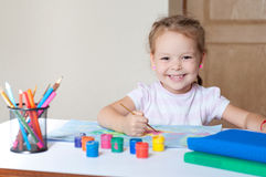 Little cute girl painting with brush Royalty Free Stock Photography