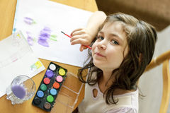 Little cute girl painting  inside Royalty Free Stock Photos