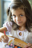 Little cute girl painting inside Stock Photography