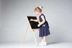 Little cute girl painting Stock Photos