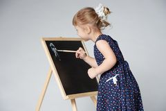 Little cute girl painting Stock Image