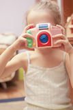 Little cute girl photographying Royalty Free Stock Images