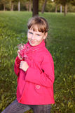 Little cute girl in pink coat in autmn park Royalty Free Stock Photography