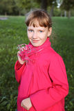 Little cute girl in pink coat in autmn park Stock Photography