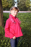 Little cute girl in pink coat in autmn park Stock Photo