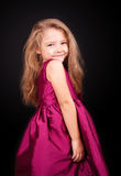 Little cute girl in a pink dress Royalty Free Stock Image