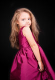 Little cute girl in a pink dress Stock Images