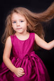 Little cute girl in a pink dress Stock Image