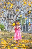Healthy Little cute girl in pink dress  with yellow flowers. Royalty Free Stock Images
