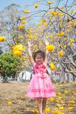 Healthy Little cute girl in pink dress  with yellow flowers. Stock Images