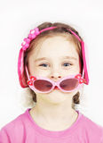 Little cute girl with pink sunglasses having fun Stock Image