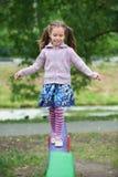 Little cute girl on playground Stock Photos