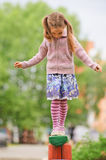 Little cute girl on playground Stock Images