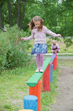 Little cute girl on playground Royalty Free Stock Image