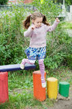 Little cute girl on playground Stock Image