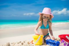 Little cute girl playing with beach toys during Stock Image