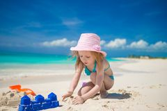 Little cute girl playing with beach toys during Stock Photo
