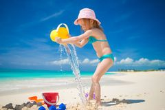 Little cute girl playing with beach toys during Stock Photography