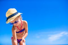 Little cute girl playing with beach toys during Stock Photos