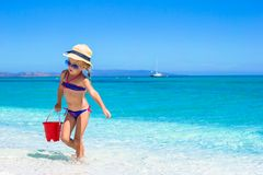 Little cute girl playing with beach toys during Royalty Free Stock Images