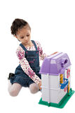 Little Cute Girl Playing with Dollhouse Toy Royalty Free Stock Photography