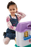Little Cute Girl Playing with Dollhouse Toy Royalty Free Stock Images