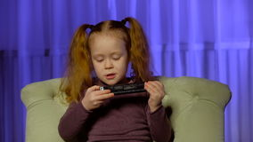 Little cute girl playing harmonica stock video footage