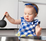 Little cute girl playing in kitchen Stock Photography