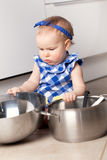 Little cute girl playing in kitchen Royalty Free Stock Photo