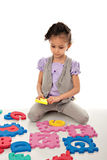 Little Cute Girl Playing Puzzle Royalty Free Stock Image