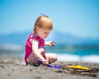 Little cute girl playing in the sand Royalty Free Stock Images