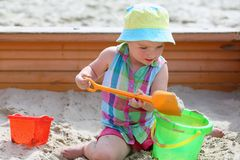 Little cute girl playing in sandbox Stock Photography