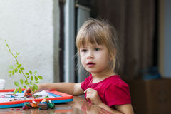 Little cute girl playing table play outside Royalty Free Stock Photos