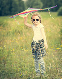 Little cute girl posing with a kite Stock Photography