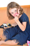 Little cute girl posing while panting her face Stock Photo