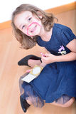 Little cute girl posing while panting her face Stock Image