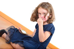 Little cute girl posing while panting her face Stock Photography