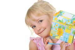 Little cute girl with present posing to camera Royalty Free Stock Photography