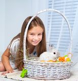 Little cute girl and rabbit Stock Images
