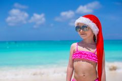 Little cute girl in red hat santa claus on the Stock Photo